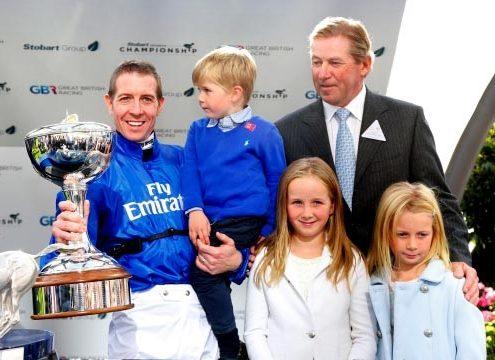 Jim Crowley celebrates winning the jockeys' championship with his family