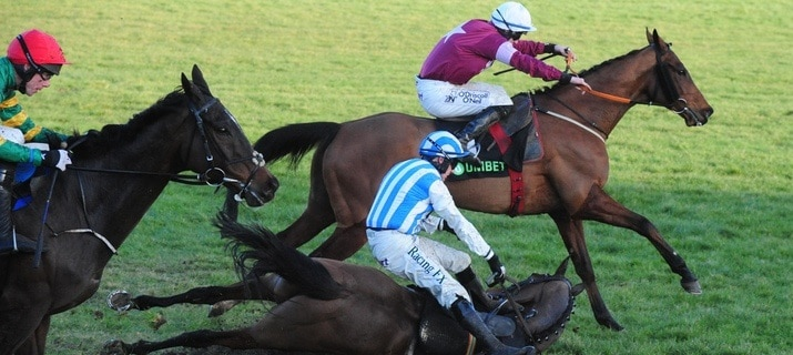 4-2-18 LEOPARDSTOWN EDWULF and Derek O'Connor (red cap) come to beat Outlander (white cap) as KILLULTAGH VIC and Paul Townend fall at the last when in the lead in the Grade 1 Unibet Irish Gold Cup. Both horse and jockey were ok after the fall. Photo Healy Racing / Racingfotos.com