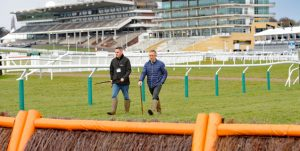 Cheltenham Racecourse 11.03.18 Clerk of the Course Simon Claisse (right) and Head Groundsperson Ben Hastie inspect the course on Sunday morning ahead of the festival starting on Tuesday 13th. Photo Andy Watts /Racingfotos.com