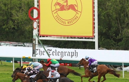 BILLESDON BROOK (green & red) ridden by Sean Levey bursts through the pack to win in The Telegraph Nursery Handicap Stakes at Glorious Goodwood 3/8/17 Photo: Ian Headington / Racingfotos.com