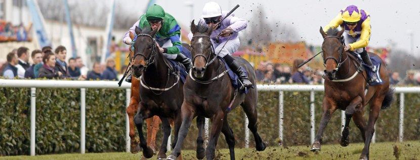 IZZER (centre, Charles Bishop) beats BROKEN SPEAR (left) in The Unibet Brocklesby Stakes Doncaster 24 Mar 2018 - Pic Steven Cargill / Racingfotos.com