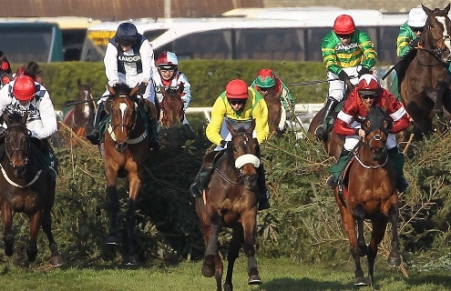 Tiger Roll and Davy Russell wins his 2nd Randox Health Grand National at Aintree from Magic Of Light, Rathvinden [left] and Walk In The Mill [2nd left] 6/4/2019 Pic Steve Davies/Racingfotos.com