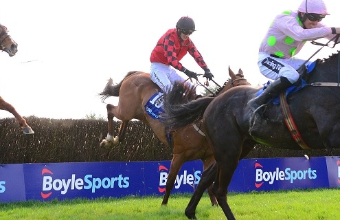 "Fairyhouse 22-4-19 BURROWS SAINT & Ruby Walsh jump the last to win the Boylesports Irish Grand National from stable companions ISLEOFHOPENDREAMS & NACAPELLA BOURGEOIS. Photo Healy Racing/ ""RACINGFOTOS.COM"""