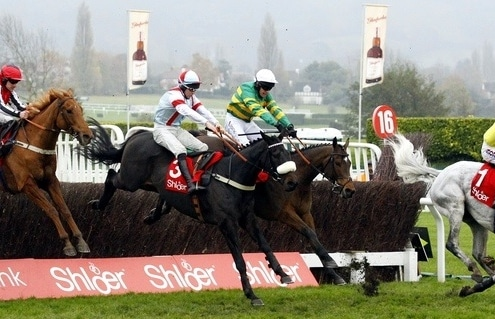 Defi Du Seuil and Barry Geraghty [green colours] wins the Shloer Chase at Cheltenham from Poltologue [yellow colours] , Saint Calvados [white/blue colours] and Simply Ned [red colours]. 17/11/2019 Pic Steve Davies/Racingfotos.com