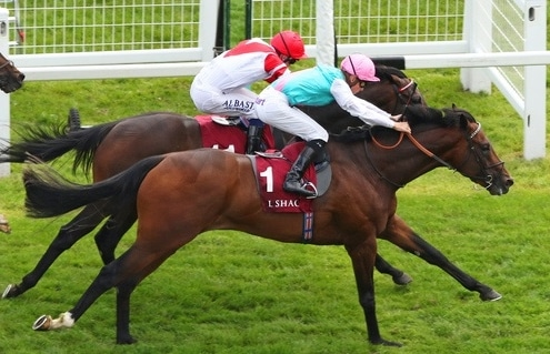 HEADMAN (pink cap) ridden by Jason Watson beating Sinjaari in The Al Zubarah London Gold Cup Handicap Stakes at Newbury 18/5/19 Photo Ian Headington / Racingfotos.com