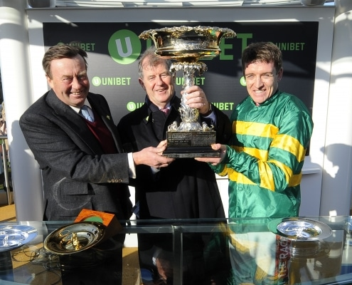 Cheltenham Festival Day 1 Cheltenham Racecourse 13.03.18 The Unibet Champion Hurdle Challenge Trophy. Barry Geraghty with Nicky Henderson and J P McManus after Buveur D'Air had won. Photo Andy Watts /Racingfotos.com